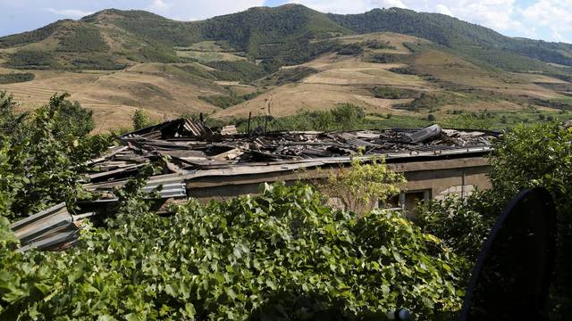A view shows a house damaged by a recent shelling in armed clashes on the border between Azerbaijan and Armenia