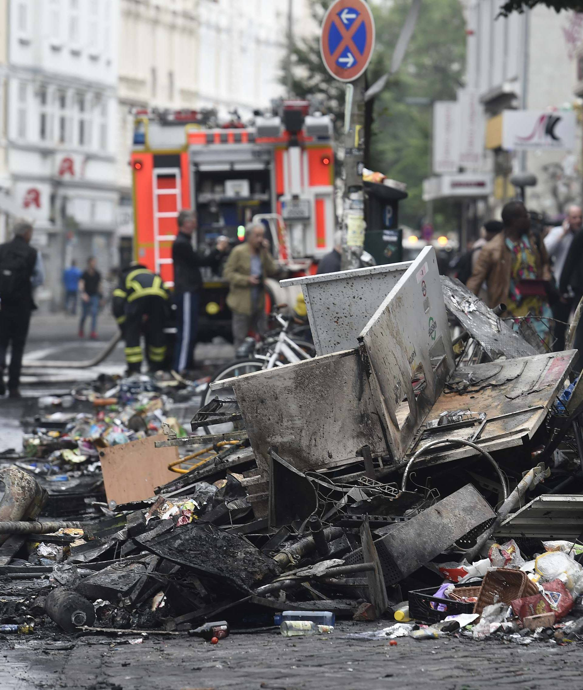 Damages are seen on a street after demonstrations at the G20 summit in Hamburg