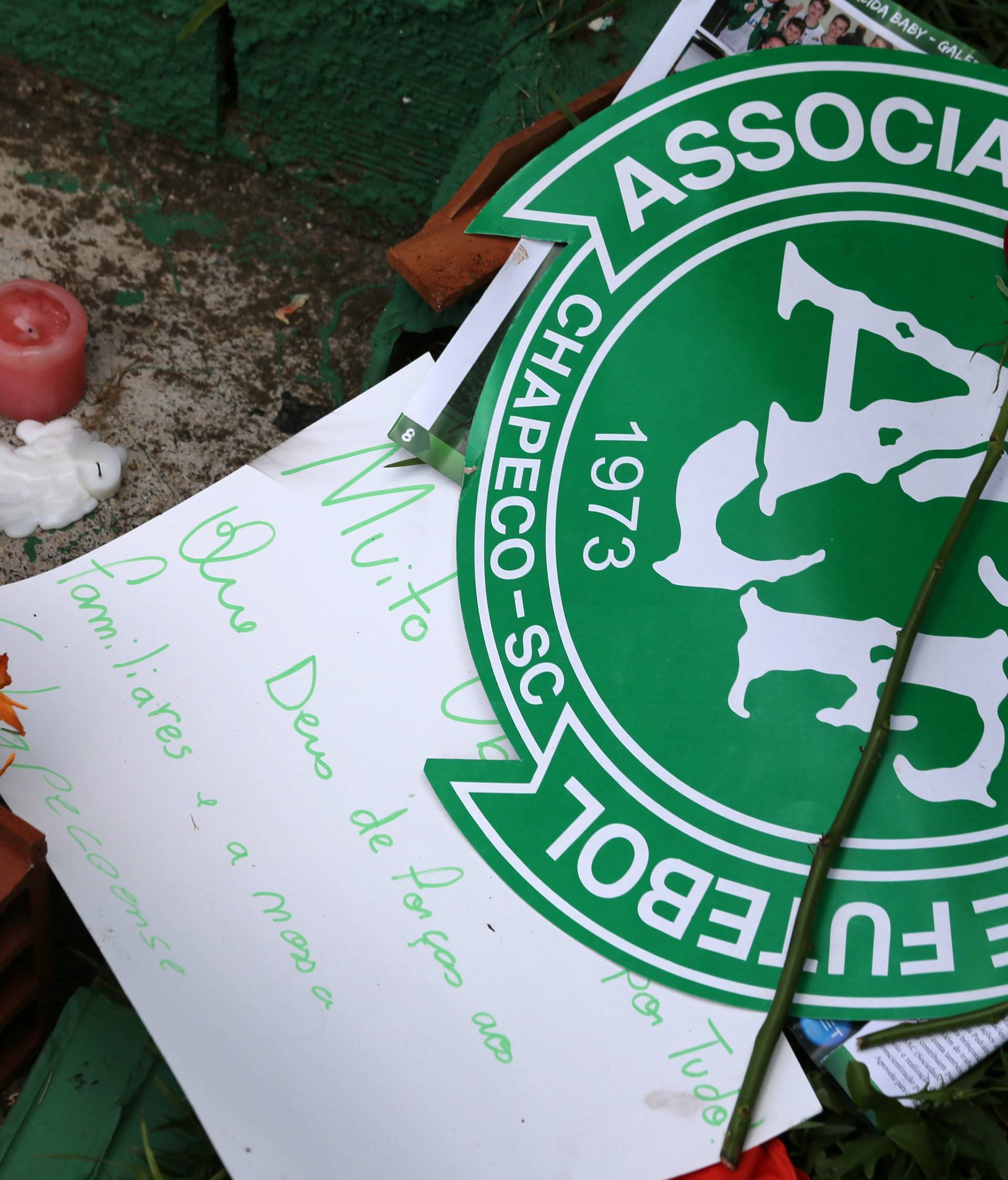 Flowers and messages are seen next a Chapecoense soccer team flag in tribute to their players in front of the Arena Conda stadium in Chapeco