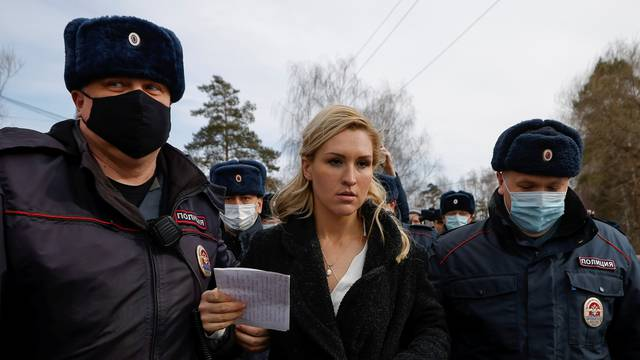 Russian police officers detain Anastasiya Vasilyeva, a doctor and ally of Kremlin critic Alexei Navalny, near the IK-2 corrective penal colony in Pokrov