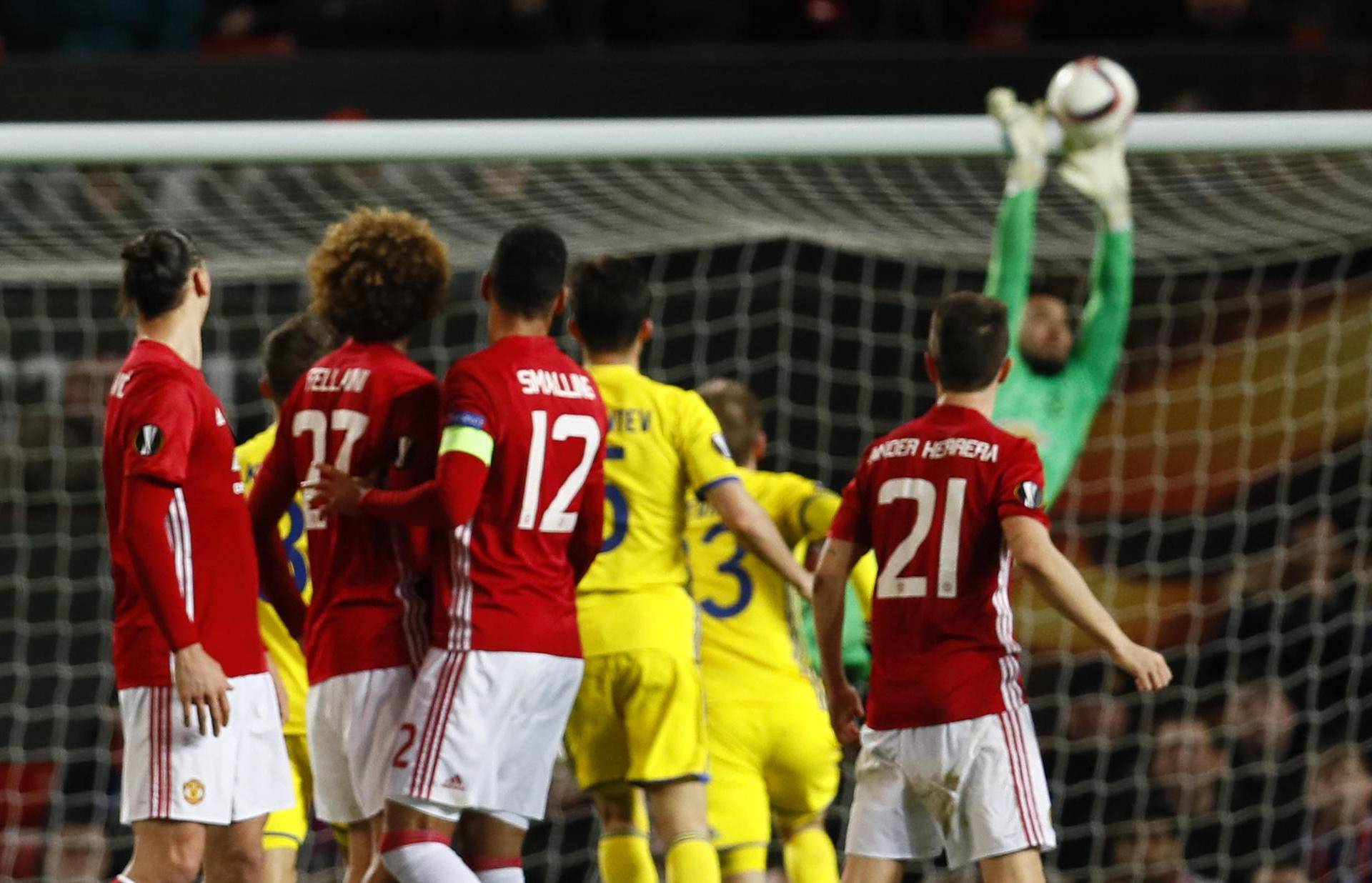 Manchester United's Sergio Romero saves a free kick from FC Rostov's Christian Noboa