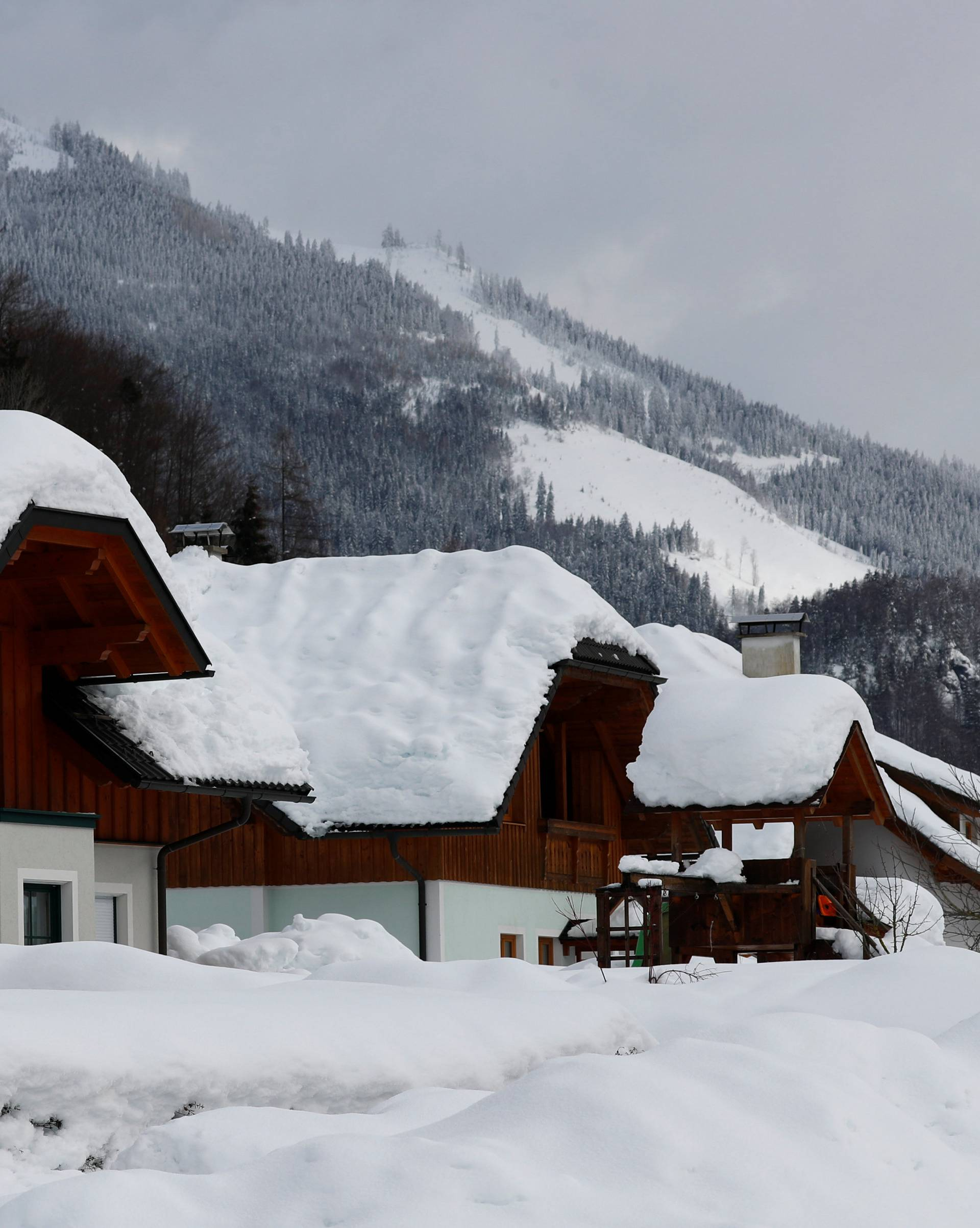 Snow covered houses are seen after heavy snowfall in Rosenau