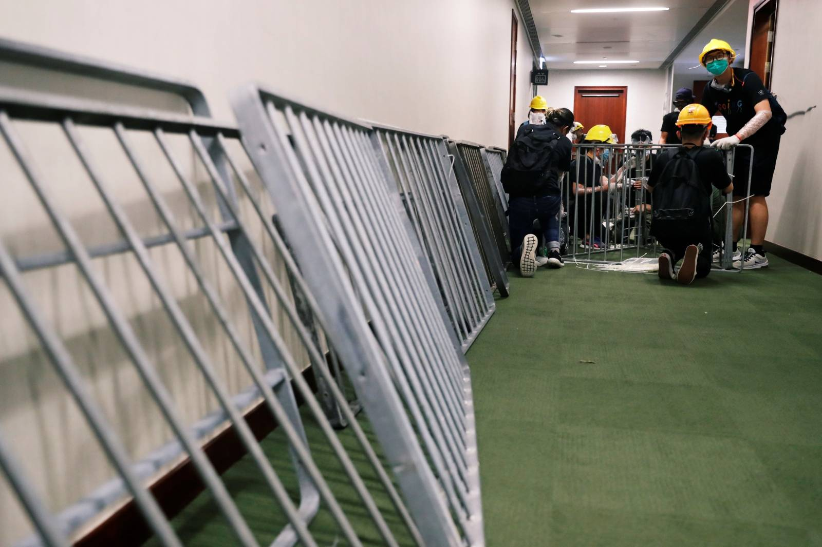 Anti-extradition bill protesters set up barricades inside the Legislative Council building after demonstrators stormed the building on the anniversary of Hong Kong's handover to China in Hong Kong