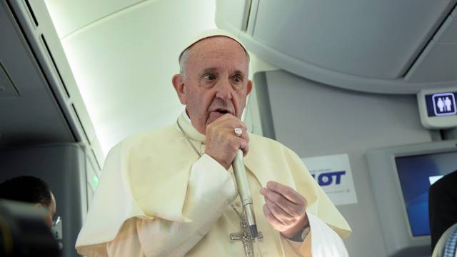 Pope Francis speaks to journalists during a press conference on the plane after his visit to Krakow for the World Youth Days