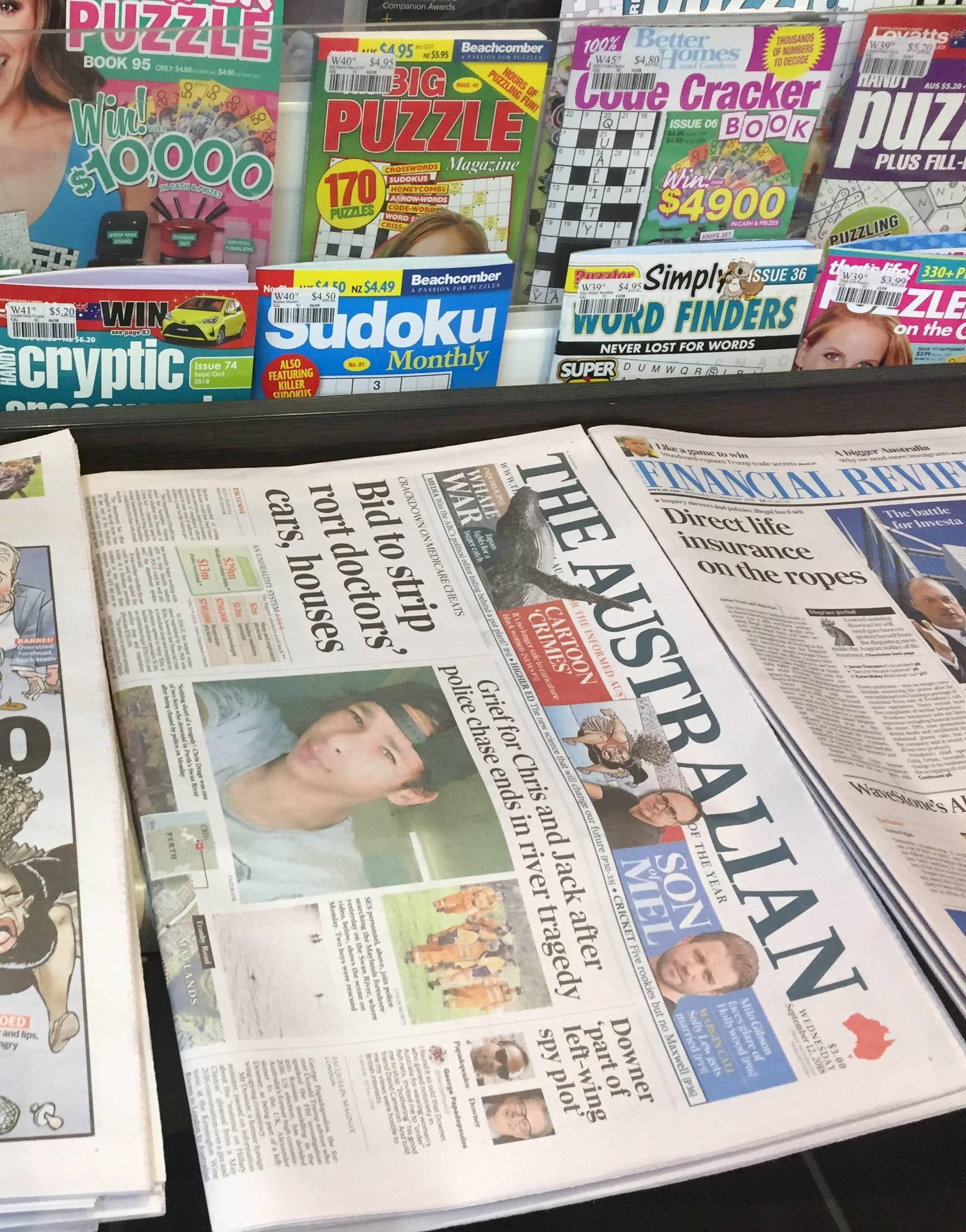 A newspaper stand displays the Herald Sun newspaper, featuring a controversial cartoon of Serena Williams, in Melbourne