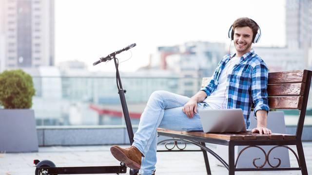 Joyful man sitting on the bench