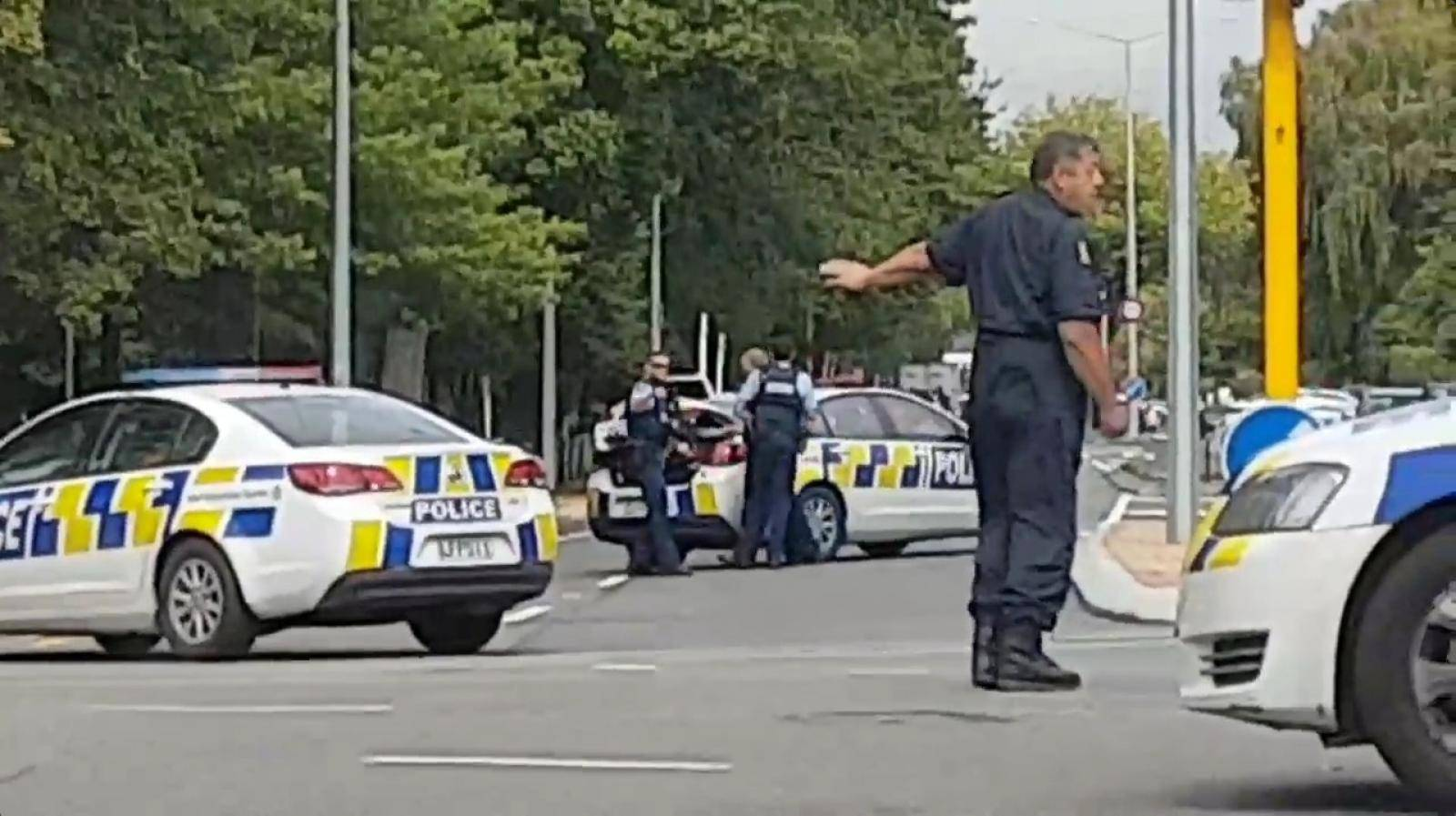 Social media video grab of police directing traffic at a road junction following reports of shootings at two mosques in Christchurch