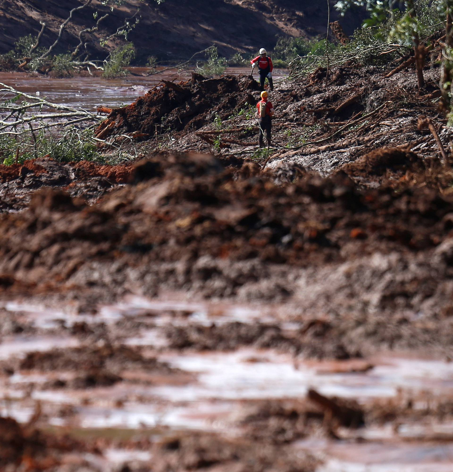 Rescue workers search for victims after a tailings dam owned by Brazilian miner Vale SA burst, in Brumadinho