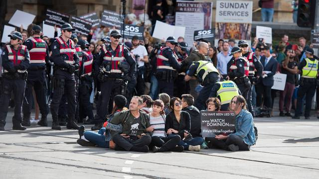 Police move in on animal rights protesters who had blocked the intersections of Flinders and Swanston Street, in Melbourne