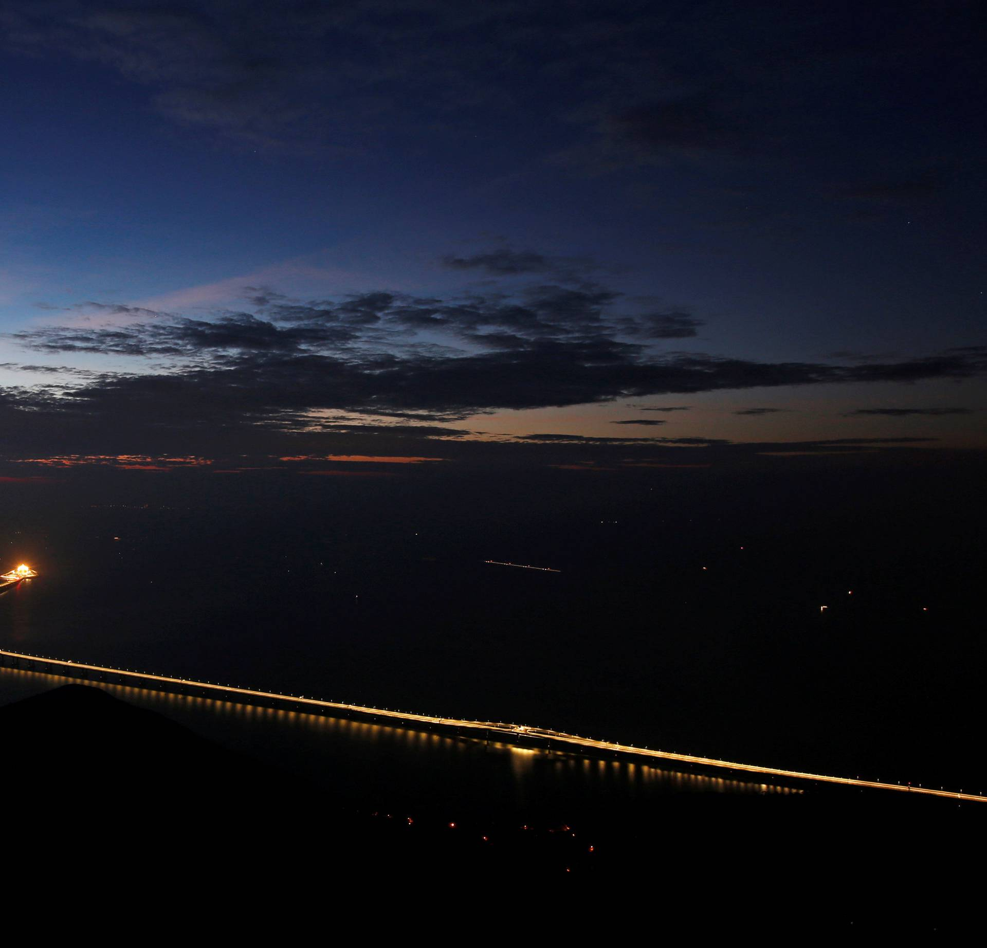 A sunset view of the Hong Kong-Zhuhai-Macau bridge off Lantau island in Hong Kong