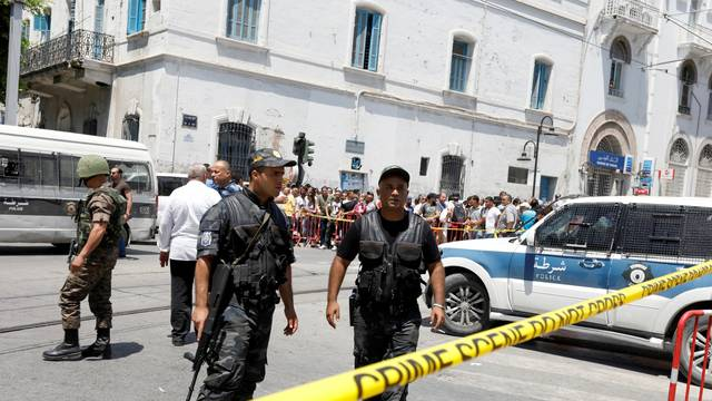 FILE PHOTO: Police officers secure the site of a suicide bombing attack in downtown Tunis