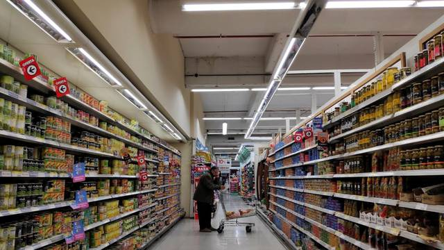 A man shops at a supermarket in Buenos Aires