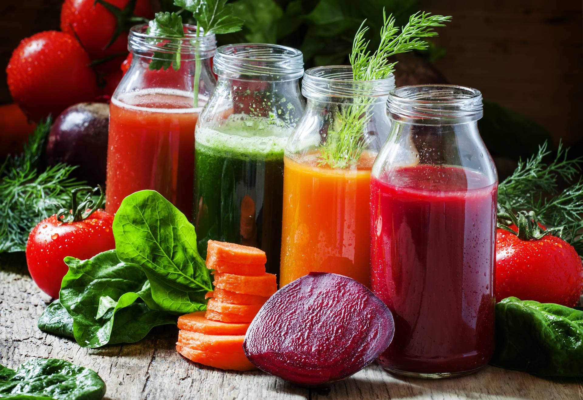 Four kind of vegetable juices: red, burgundy, orange, green