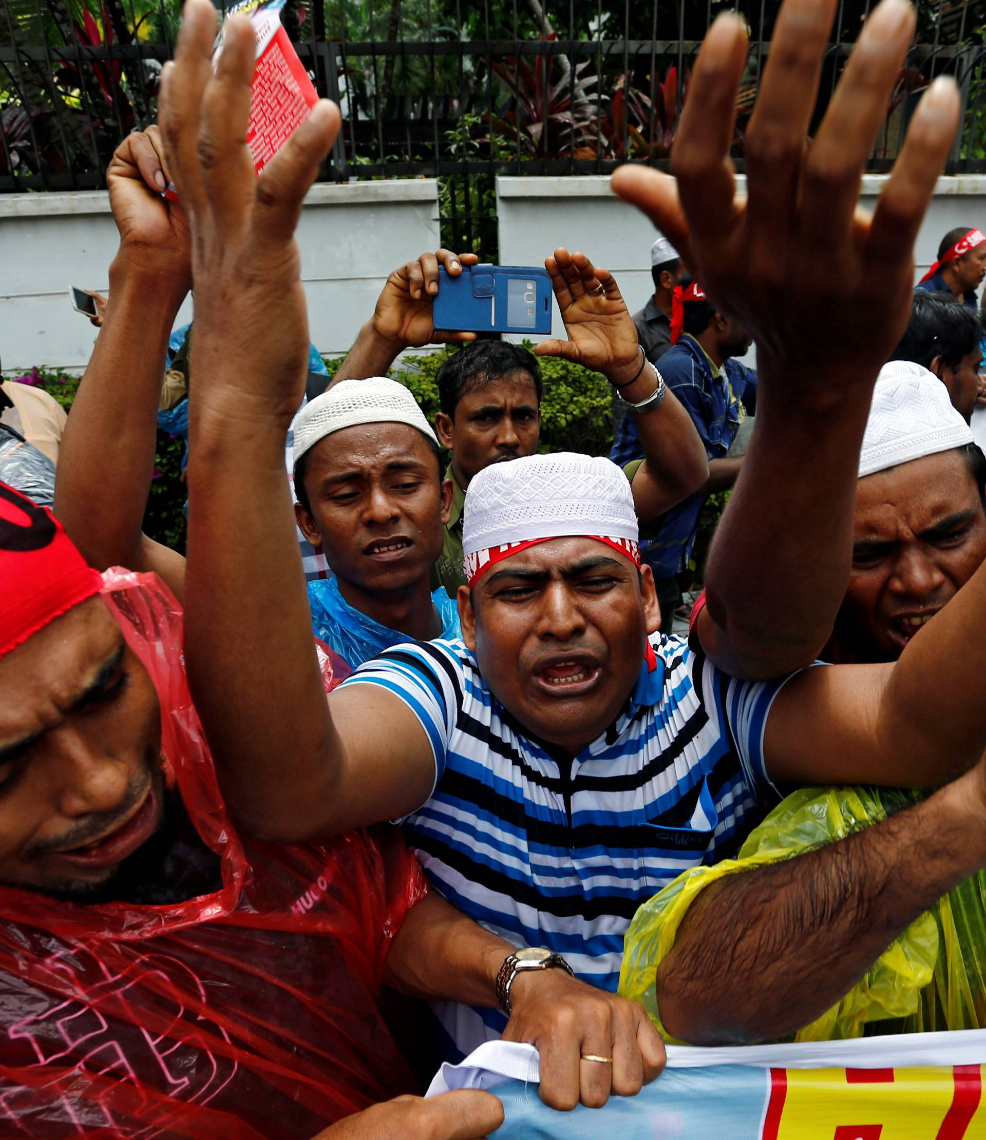 Rohingyas living in Malaysia protest against the treatment of Myanmar's Rohingya Muslims near the Myanmar embassy in Kuala Lumpur