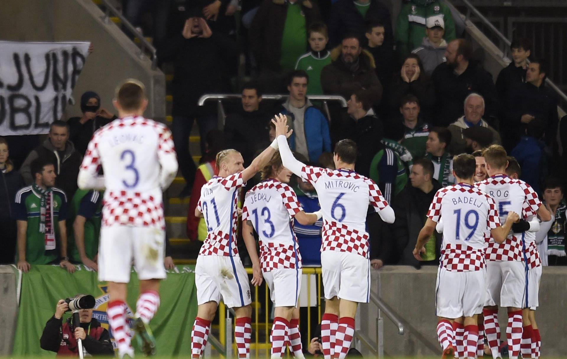 Croatia's Duje Cop celebrates scoring their second goal with teammates