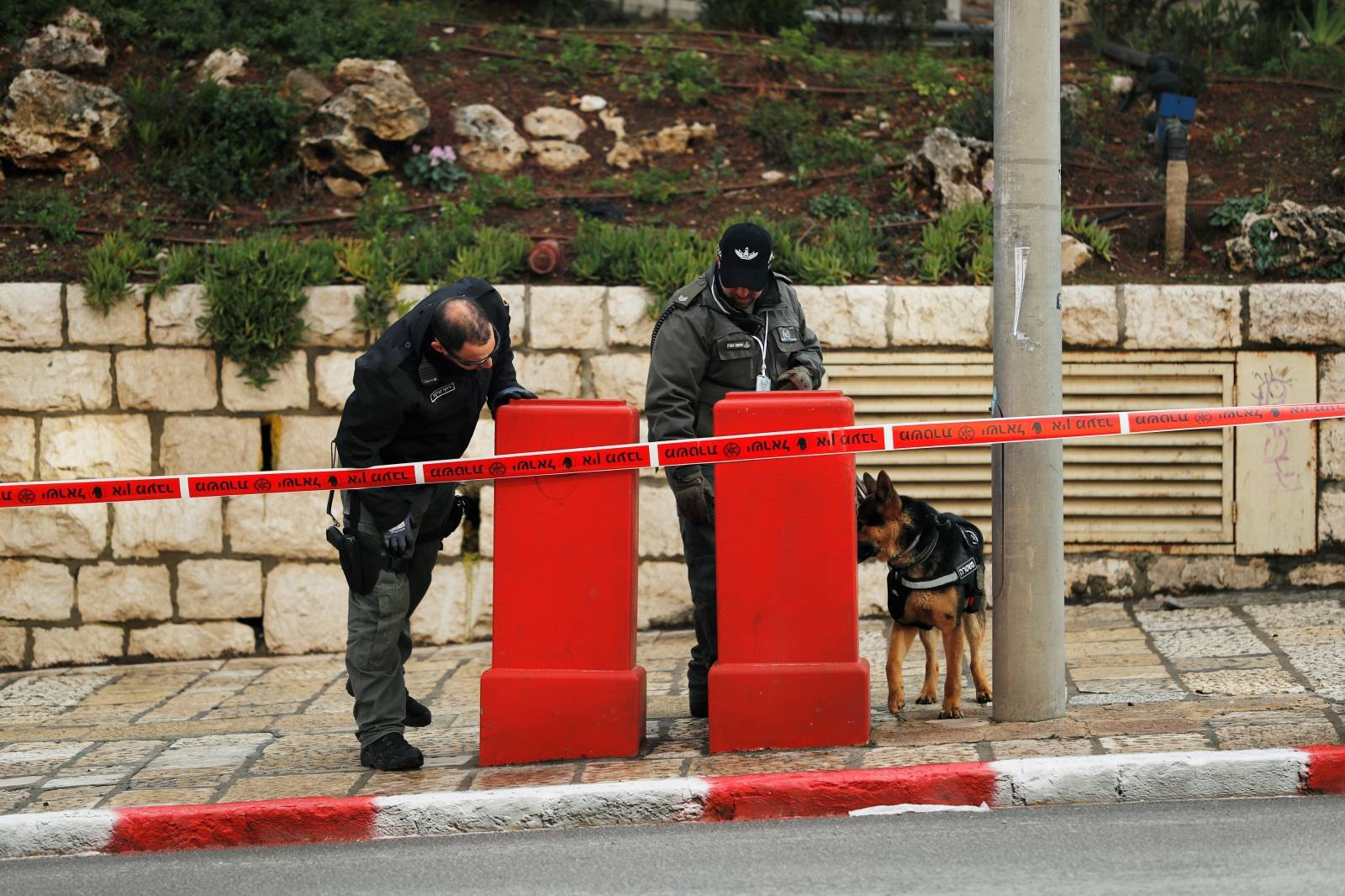 Israeli policemen and a police dog patrol the area as the city gears up to host a Holocaust memorial event at Yad Vashem, in Jerusalem