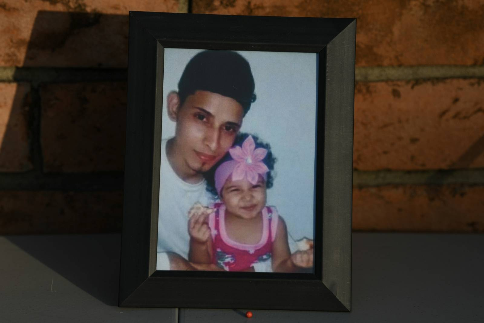 The lives of a Salvadoran migrant and his 23 month-old daughter, who drowned in the Rio Grande, are honored during a vigil in Brownsville