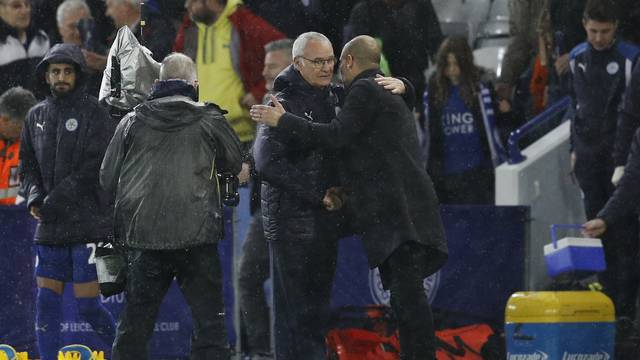 Manchester City manager Pep Guardiola and Leicester City manager Claudio Ranieri embrace at the end of the match