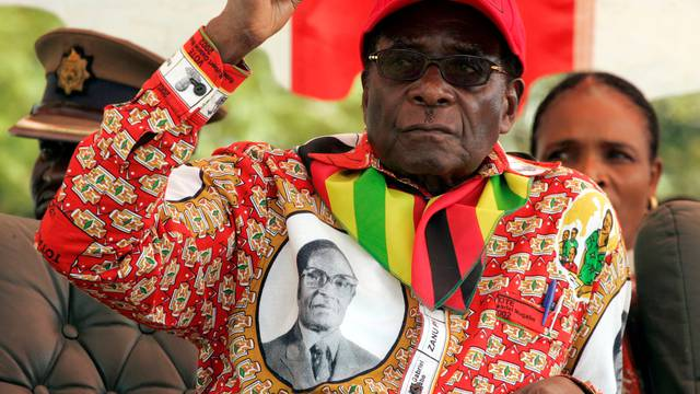 FILE PHOTO -  File photo of Zimbabwe's President Robert Mugabe gesturing at an election rally in the small town of Shamva