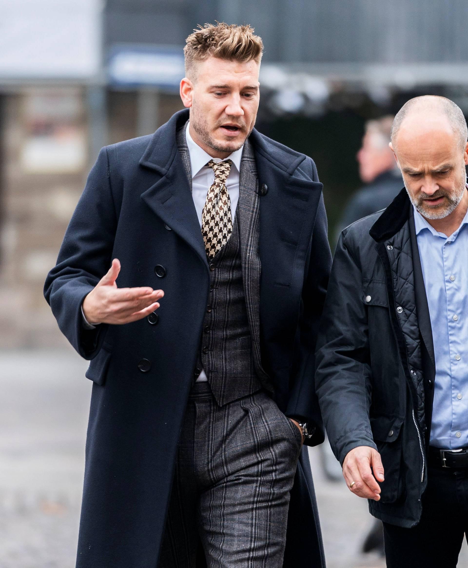 Denmark striker Nicklas Bendtner and lawyer Anders Nemeth arrive at the Copenhagen City Council