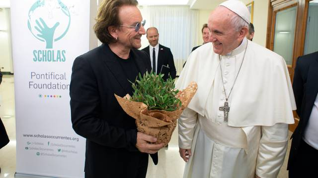 U2 rock band frontman Bono Vox meets Pope Francis at the Vatican