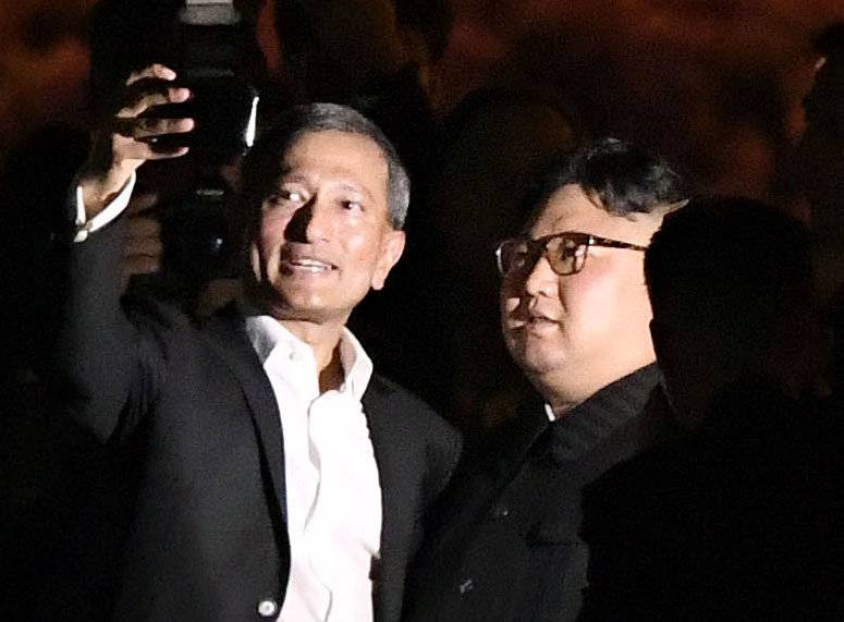 Singapore's Foreign Minister Vivian Balakrishnan takes a selfie with North Korea's leader Kim Jong Un during a visit in Merlion Park in Singapore