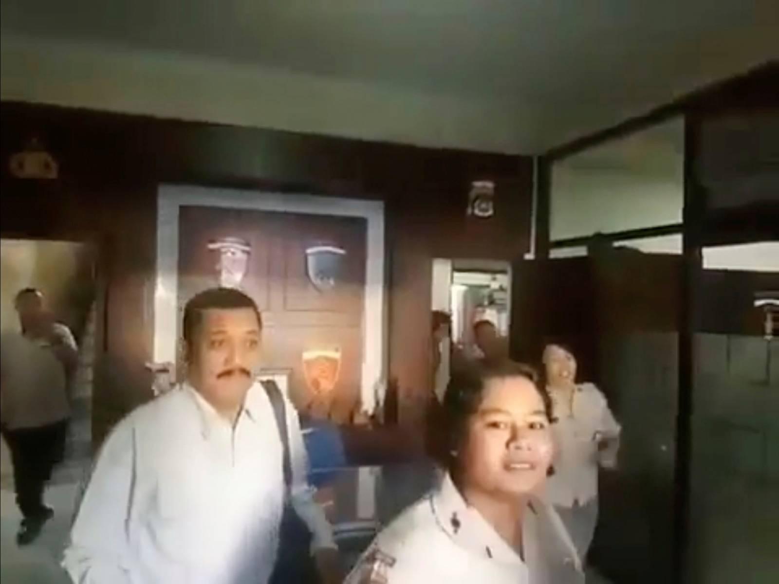Civil servants evacuate from a building as an undersea quake struck south of Bali