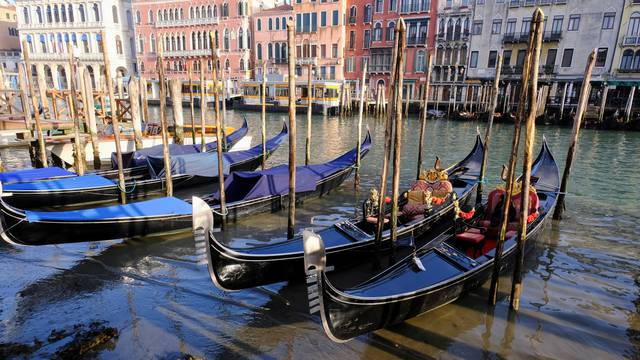 Gondolas are seen in Grand Canal during an exceptionally low tide in the lagoon city of Venice