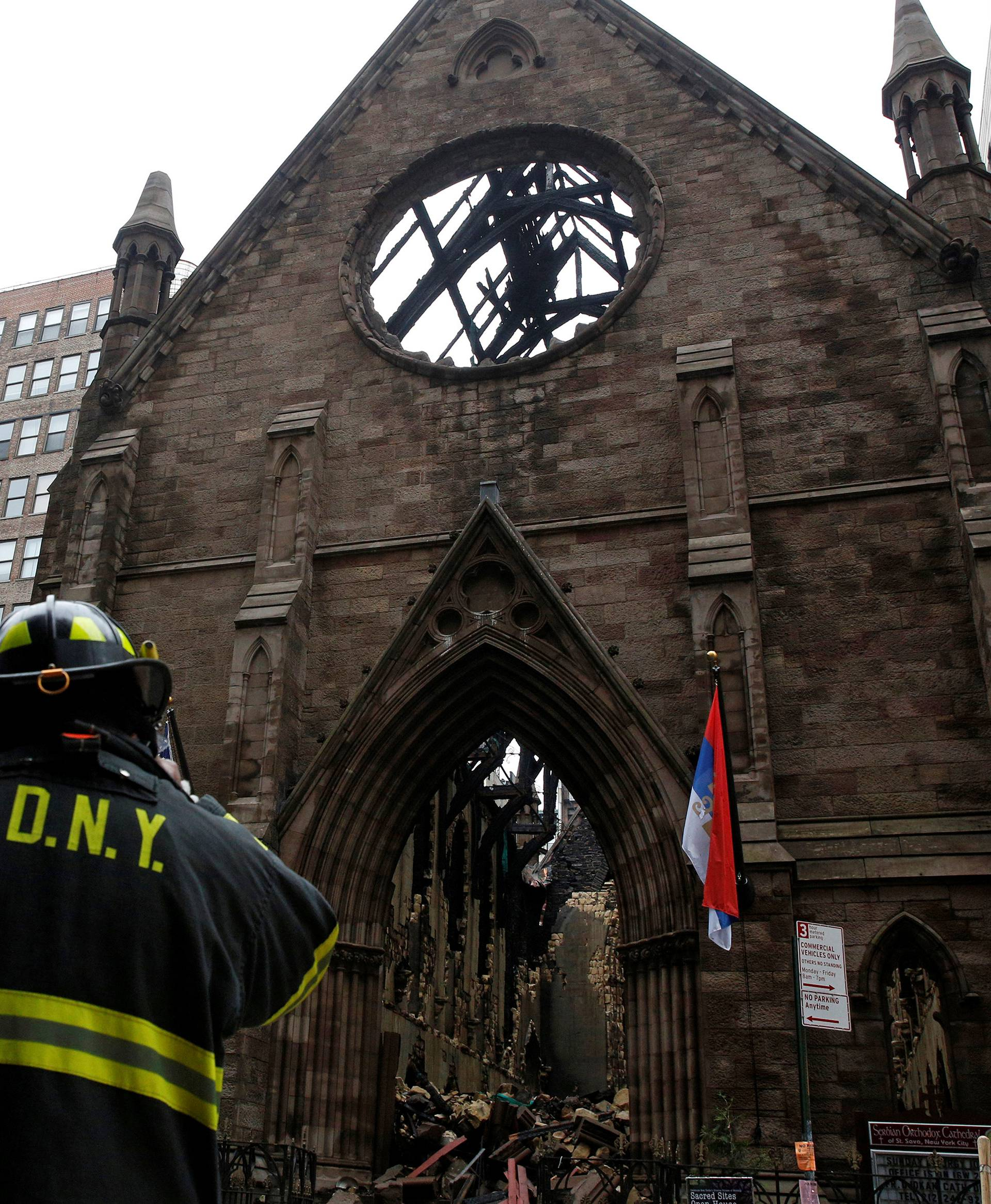 New York City firefighters (FDNY) stand in front of Manhattan's historic Serbian Orthodox Cathedral of Saint Sava following a fire in New York City