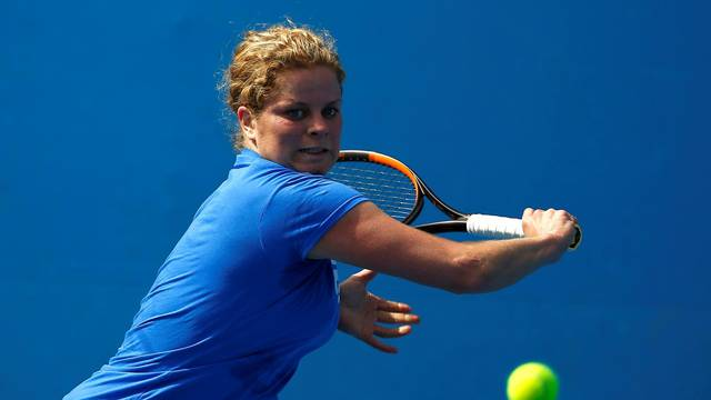 FILE PHOTO: Belgium's Kim Clijsters hits a shot during a practice session at Melbourne Park, Australia