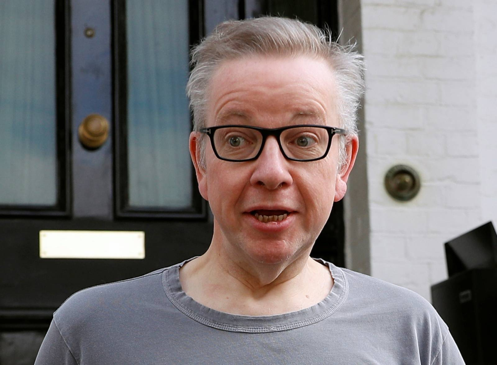 Britain's Secretary of State for Environment, Food and Rural Affairs Michael Gove leaves his home in London
