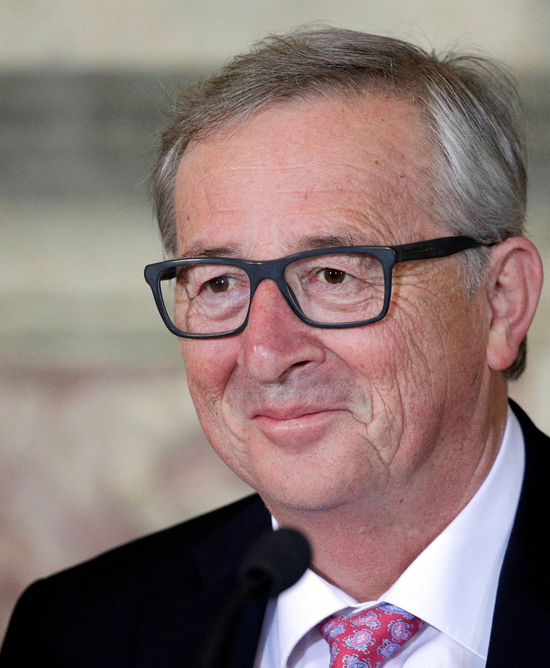 European Commission President Juncker looks on during a meeting at the Capitol Hill in Rome