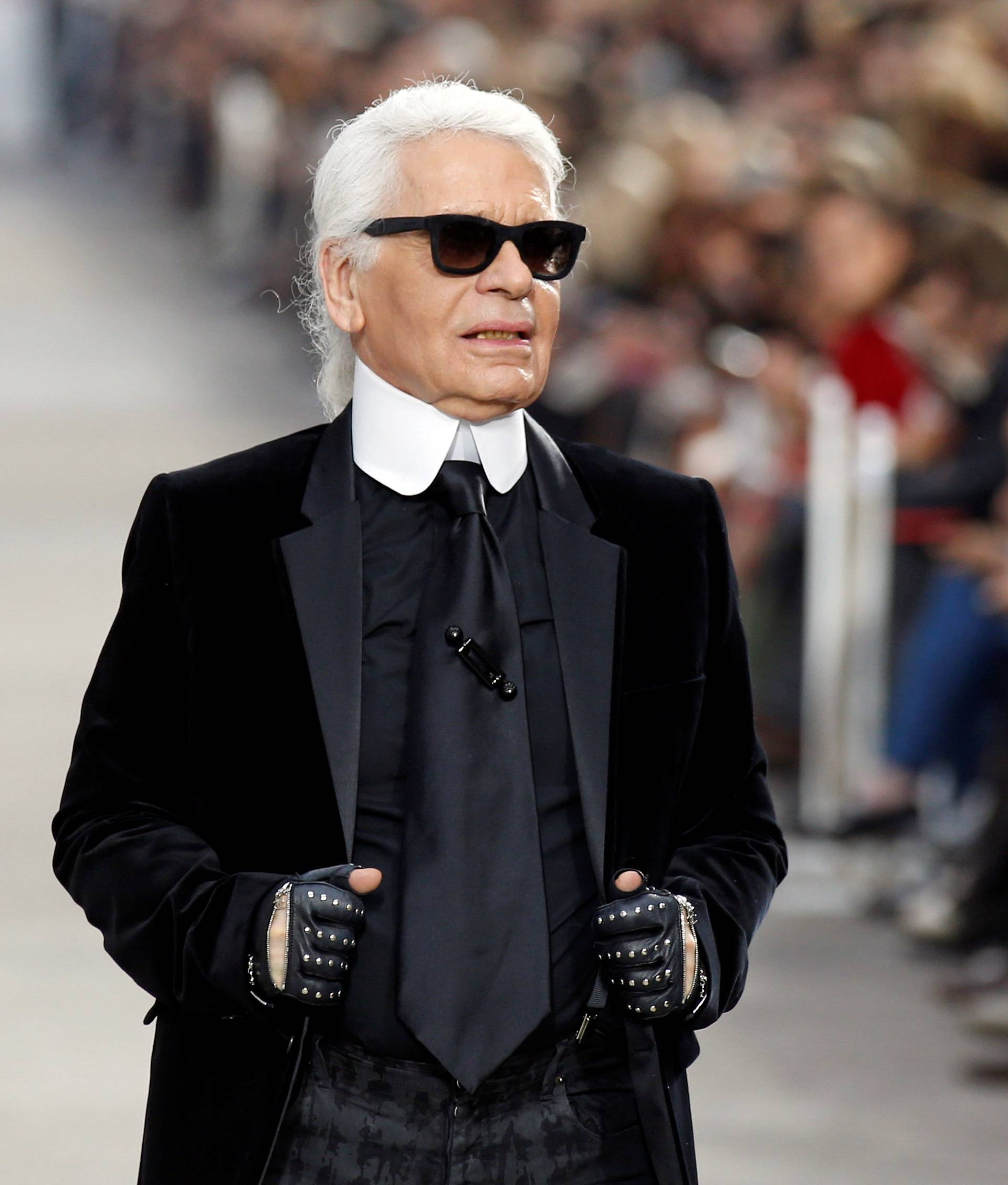 FILE PHOTO -  German designer Karl Lagerfeld appears at the end of his Spring/Summer 2014 women's ready-to-wear fashion show for French fashion house Chanel during Paris fashion week
