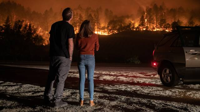 Napa Valley residents watch the Glass Fire burn in Calistoga, California
