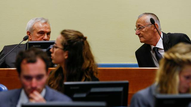 FILE PHOTO: Jovica Stanisic (L) and Franko Simatovic appear in court for their re-trial at the United Nations tribunal for the former Yugoslavia in The Hague