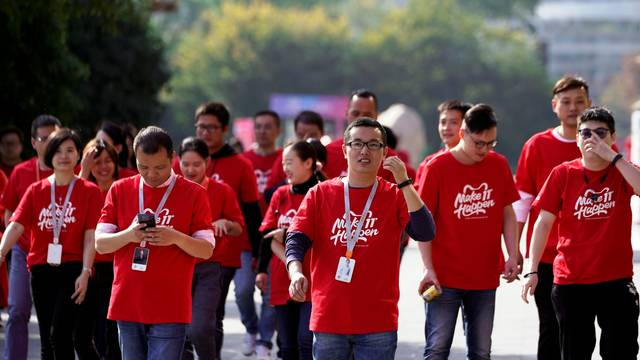 Employees of Alibaba walk during Alibaba Group's 11.11 Singles' Day global shopping festival at the company's headquarters in Hangzhou