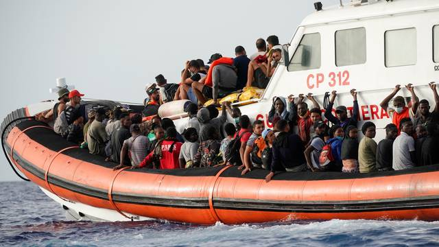 Migrants from different rescued boats are on board an Italian Guardia Costiera ship close to the island of Lampedusa