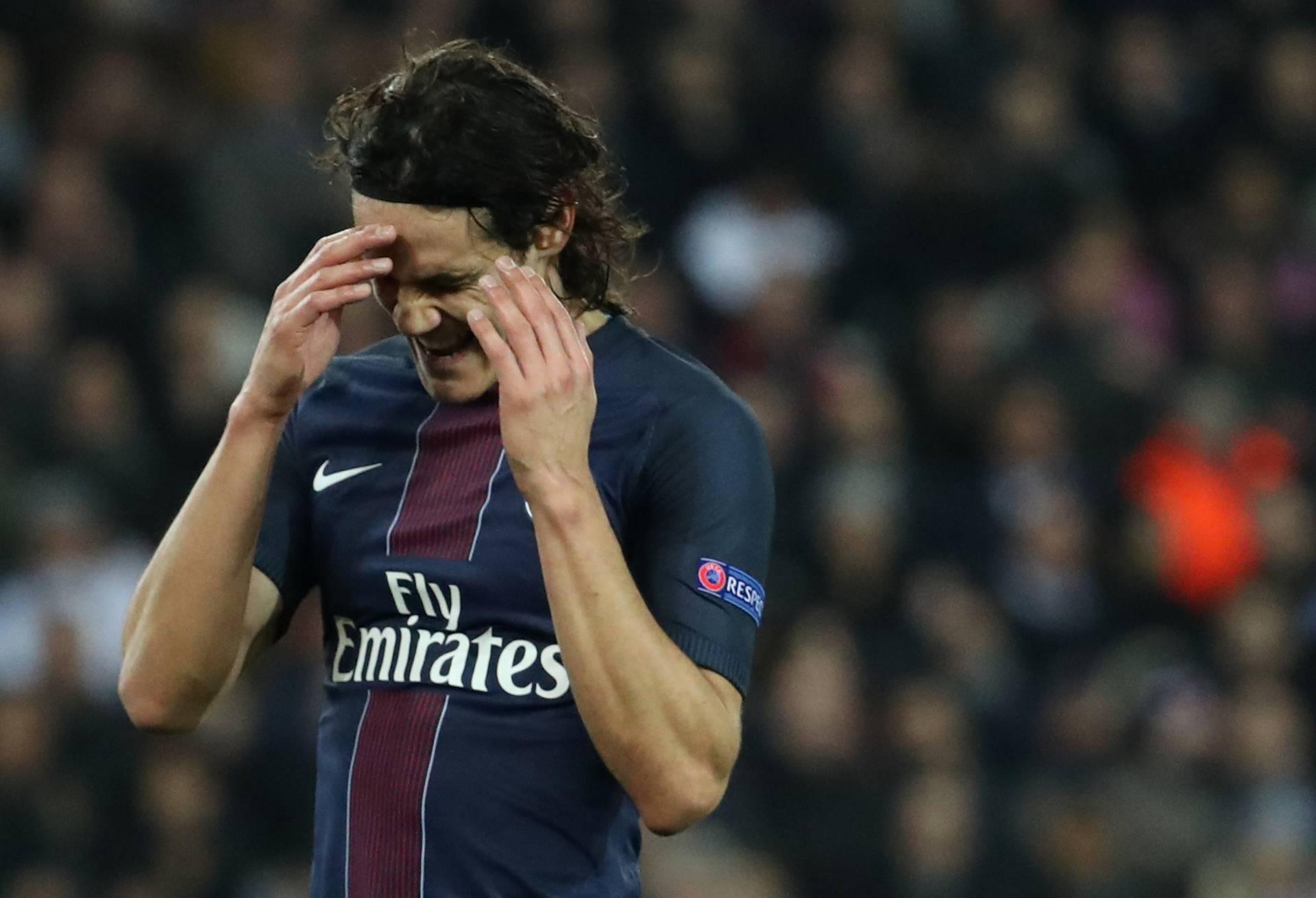 Paris Saint-Germain's Edinson Cavani looks dejected