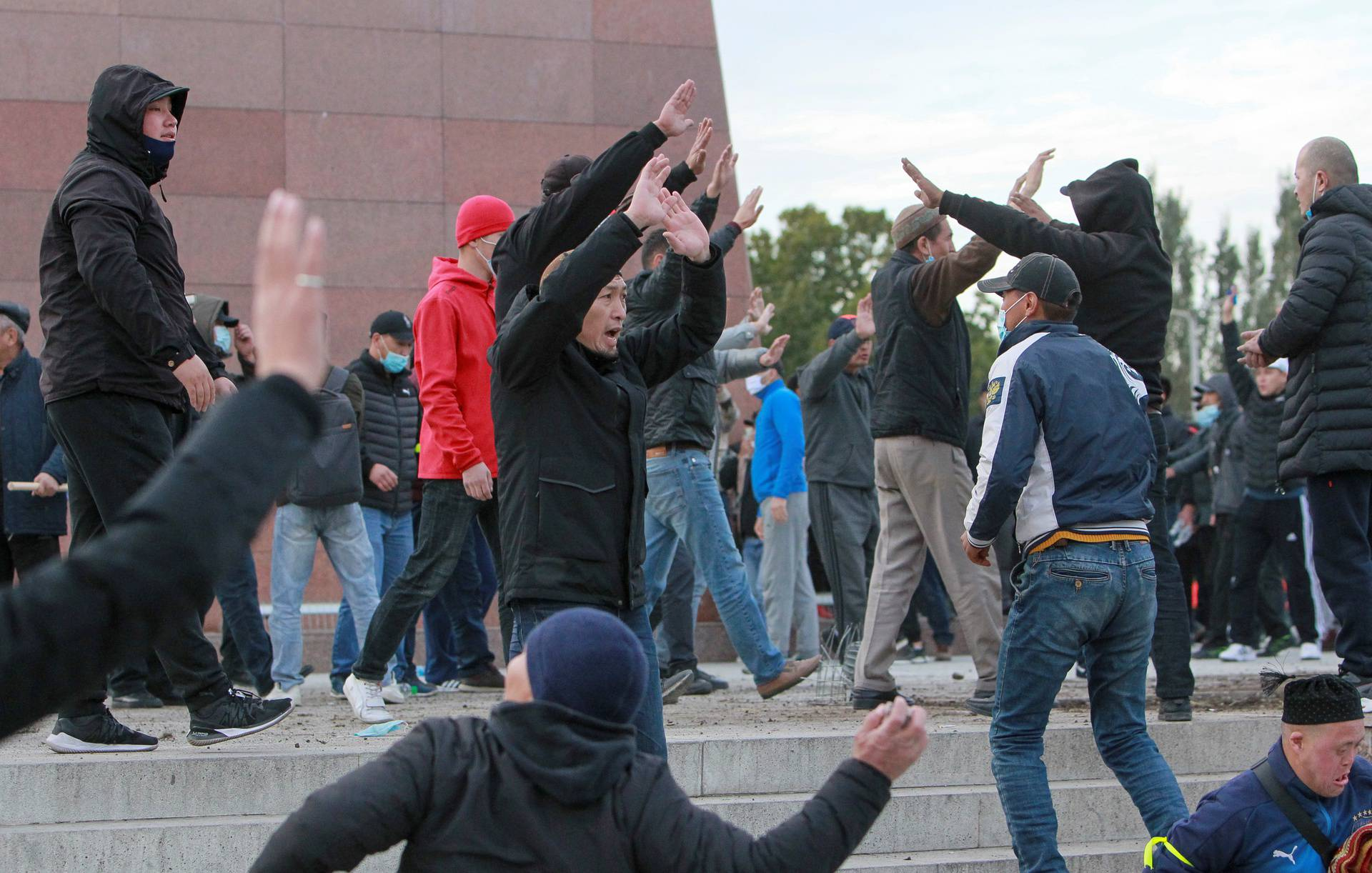 Demonstrators from rival political groups react during a rally in Bishkek