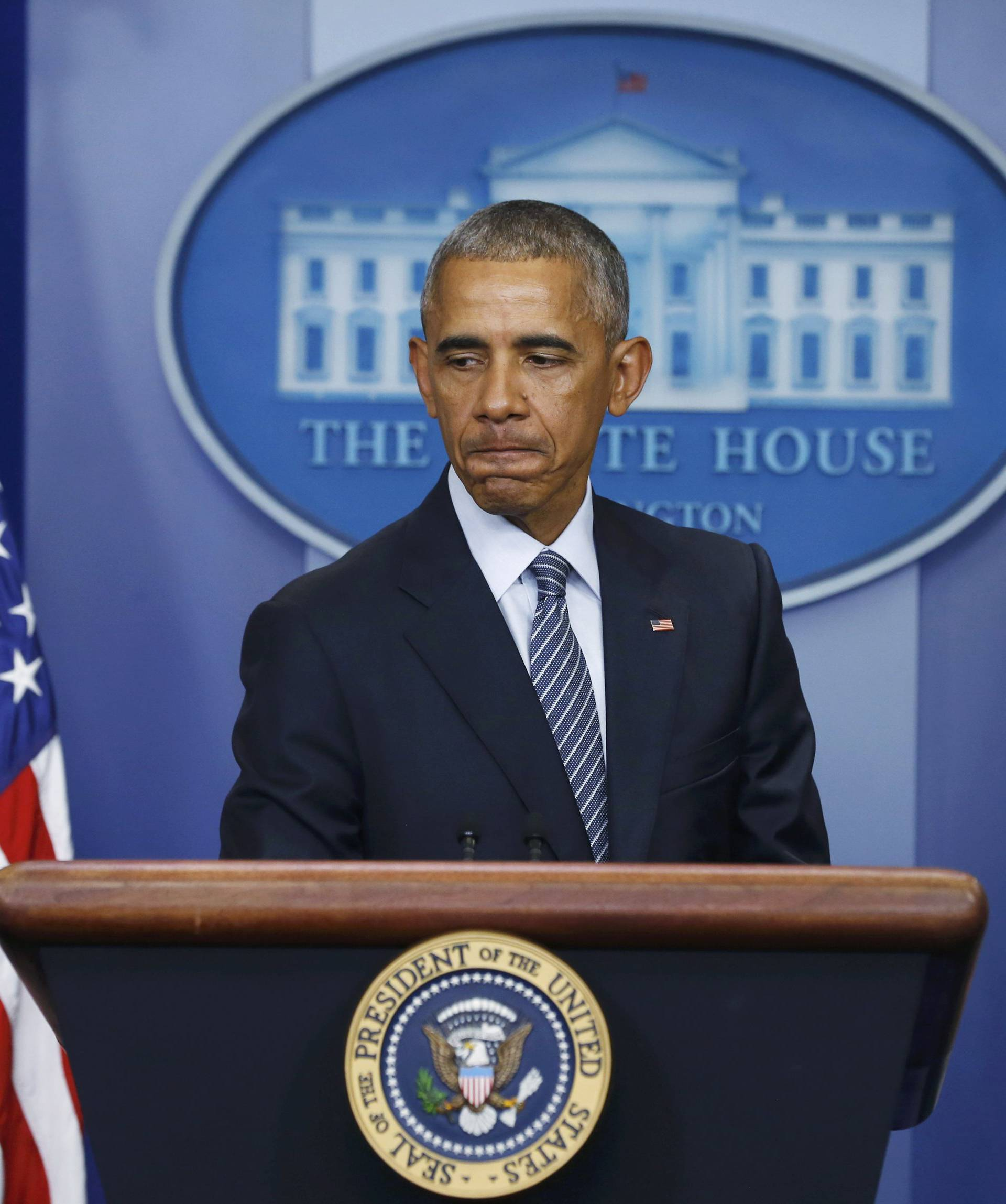 U.S.  President Obama pauses during news conference at the White House in Washington