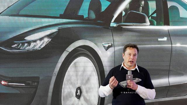 FILE PHOTO: Tesla Inc CEO Elon Musk speaks onstage during a delivery event for Tesla China-made Model 3 cars at its factory in Shanghai