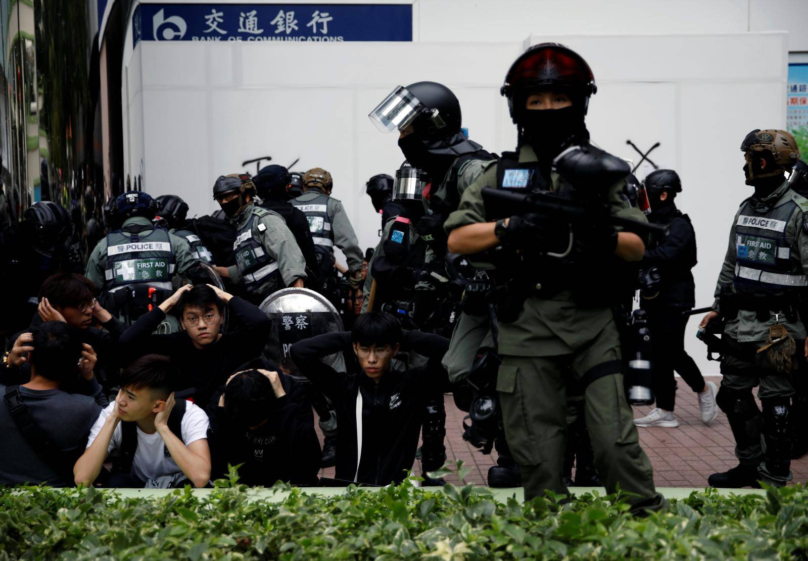 Police detain anti-government protesters after an anti-parallel trading protest at Sheung Shui, a border town in Hong Kong
