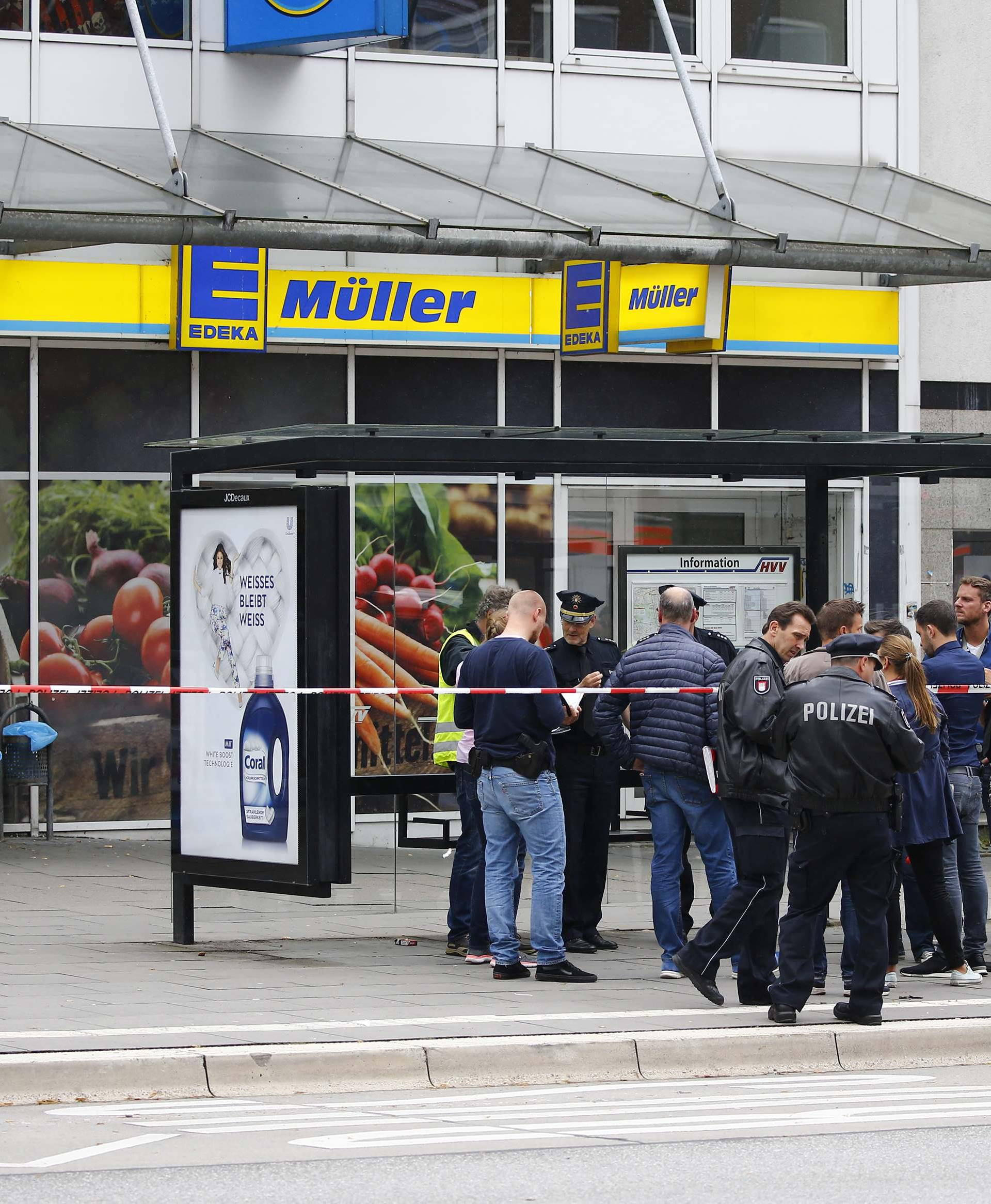 Security forces are seen after a knife attack in a supermarket in Hamburg