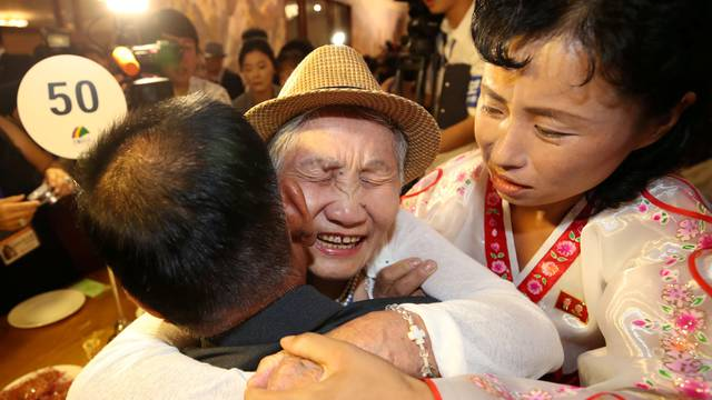 North and South Korean family members meet during a reunion at North Korea's Mount Kumgang resort