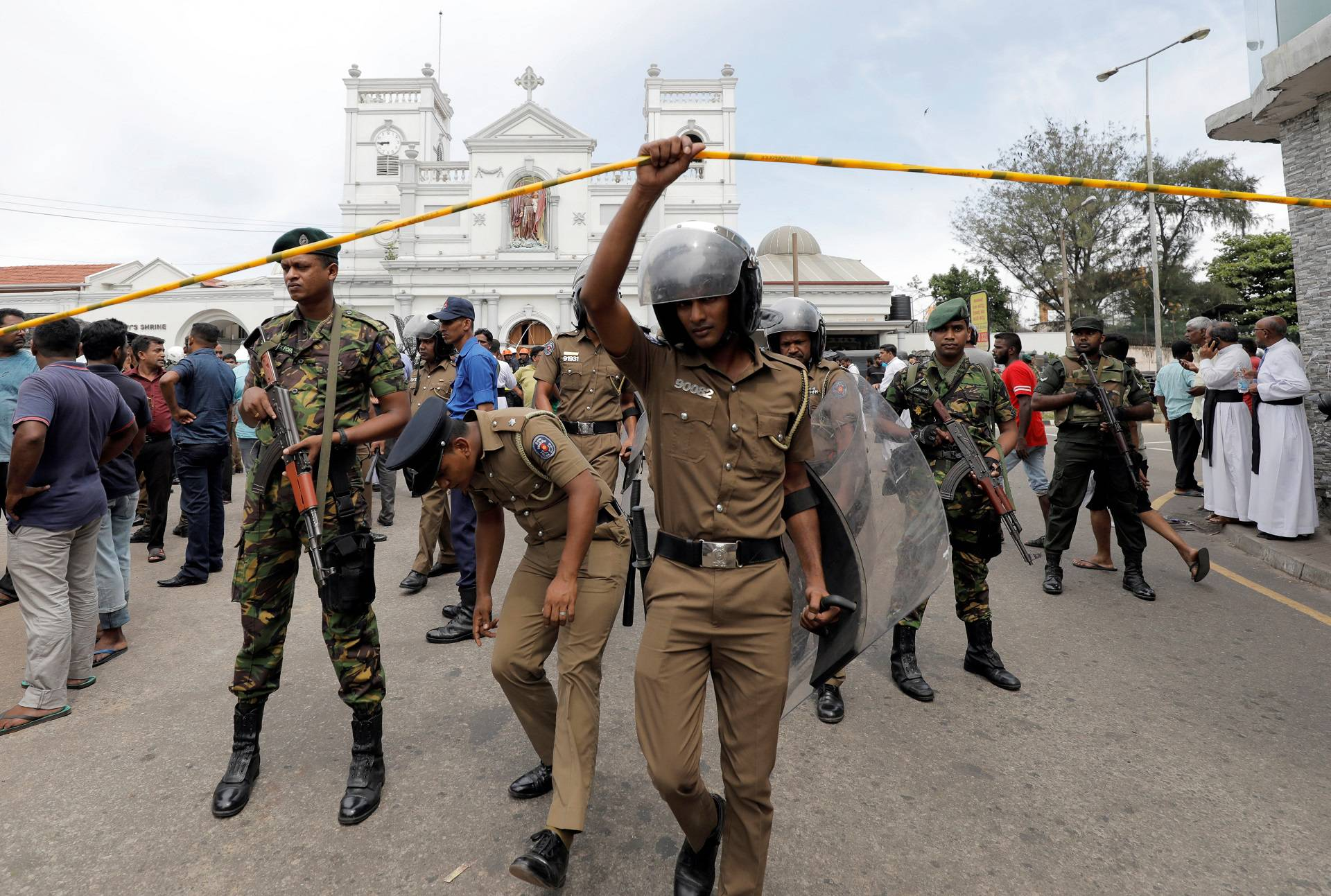Sri Lankan military officials stand guard in front of the St. Anthony's Shrine, Kochchikade church after an explosion in Colombo