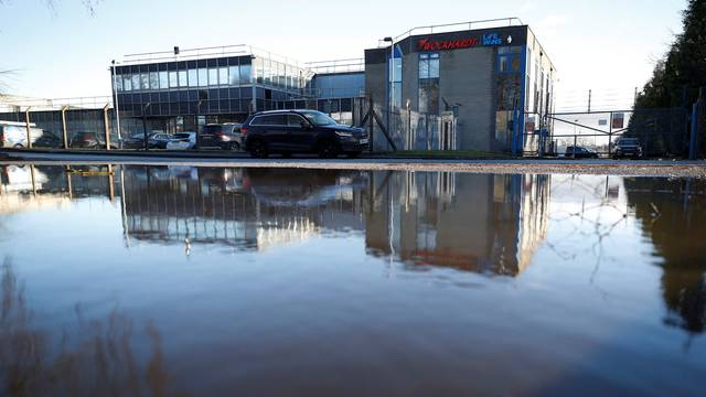 The Wockhardt pharmaceutical plant is reflected in a puddle in Wrexham