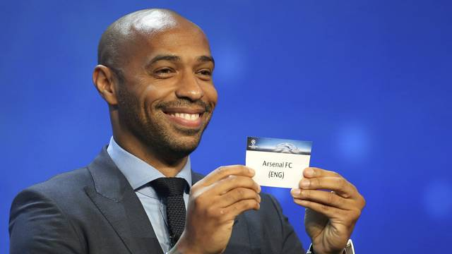 Former soccer player Thierry Henry holds a paper with the name of Arsenal FC during the draw ceremony for the 2016/2017 Champions League Cup soccer competition at Monaco's Grimaldi Forum in Monaco