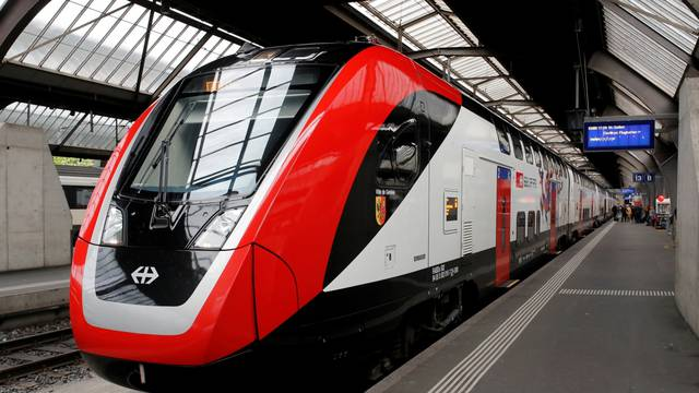 """FILE PHOTO: The Bombardier FV-Dosto double-deck train """"Ville de Geneve"""" of Swiss railway operator SBB is seen at the central station in Zurich"""