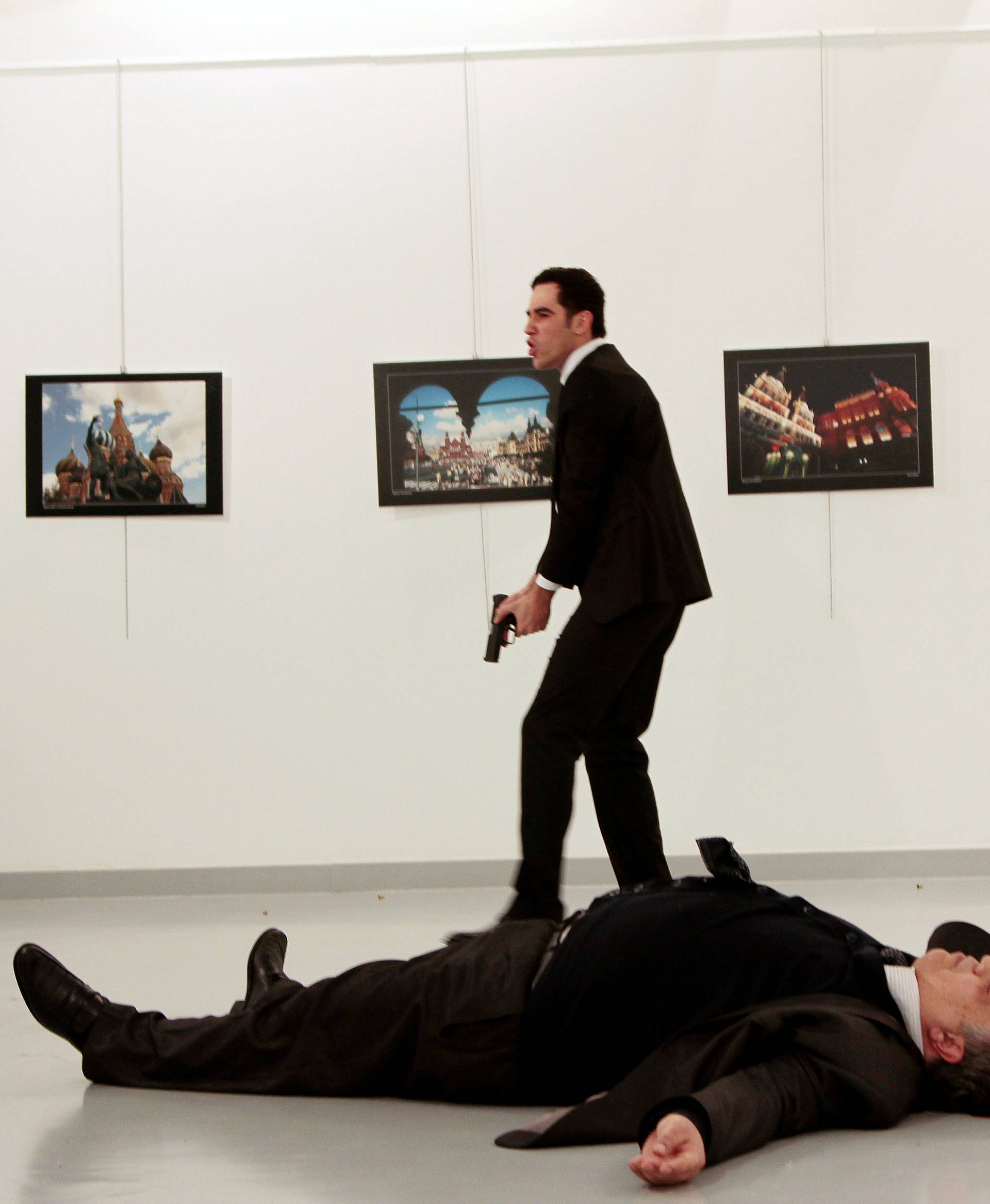 Russian Ambassador to Turkey Andrei Karlov lies on the ground after he was shot by Mevlut Mert Altintas at an art gallery in Ankara