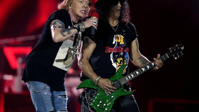 """Axl Rose and Slash, lead singer and lead guitarist of U.S. rock band Guns N' Roses, perform during their """"Not in This Lifetime... Tour"""" at the du Arena in Abu Dhabi"""